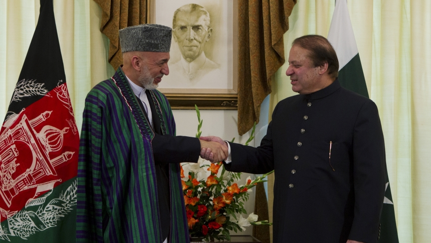 Afghan President Hamid Karzai shakes hands with Pakistan's Prime Minister Nawaz Sharif at the prime minister's residence in Islamabad