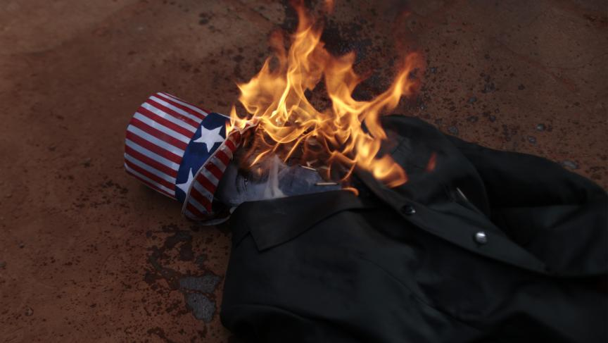 A burning effigy of President Barack Obama is seen during a protest by Brazilian students against possible US military action in Syria, in front of the US embassy in Brasilia last month.