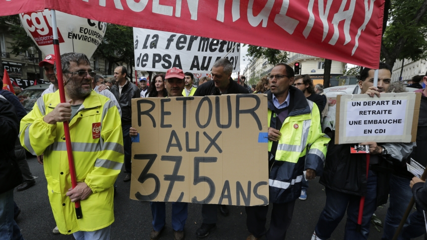Employees of PSA Peugeot Citroen Aulnay-sous-Bois automotive plant demonstrate over pension reforms in Paris, September 10, 2013. PSA has laid off thousands of workers, in small part because of business lost from Iran sanctions.