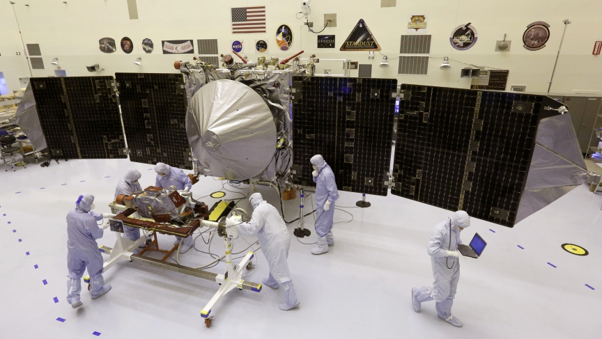 NASA technicians work on a Mars-bound spacecraft. Unmanned missions to Mars have mostly been successful, but the effort to sent a human being there is proving a harder task — and a harder sell.