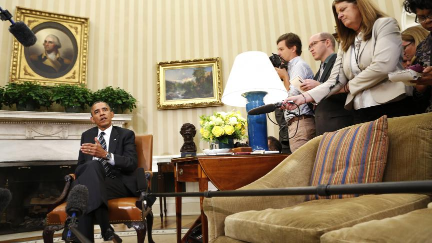US President Barack Obama speaks to reporters about Syria in the Oval Office of the White House on September 27, 2013.