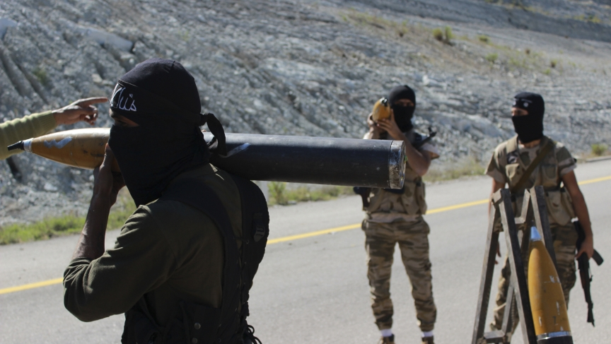 Free Syrian Army fighters prepare rockets
