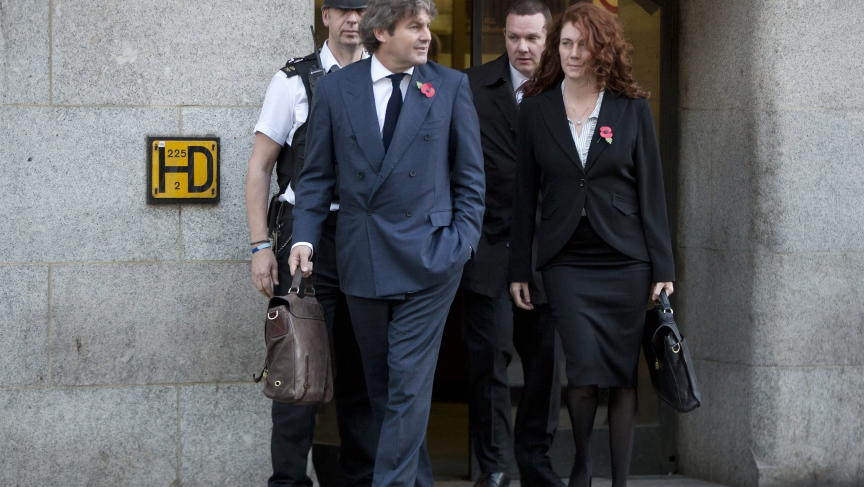 Former News International chief executive Rebekah Brooks and her husband