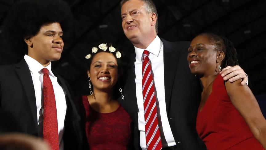 Democrat Bill de Blasio (2nd R) hugs his wife Chirlane McCray (R) and children Chiara and Dante