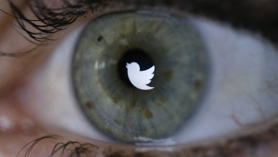 An illustration picture shows the Twitter logo reflected in the eye of a woman in Berlin.