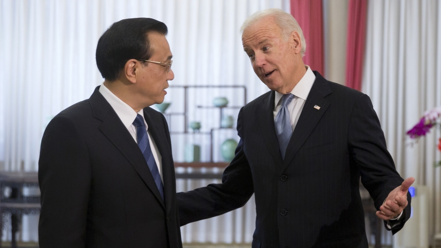 U.S. Vice President Joe Biden chats with Chinese Premier Li Keqiang in Beijing on December 5, 2013. Biden raised the issue of press freedom with China.