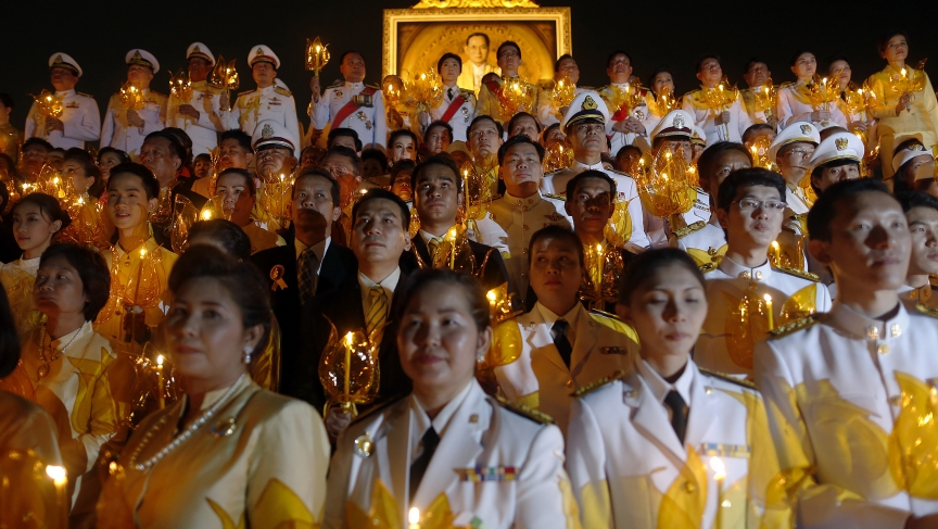 Well wishers, including Thai Prime Minister Yingluck Shinawatra (top C), attend birthday celebrations for Thailand's revered King Bhumibol Adulyadej in Bangkok on December 5, 2013.