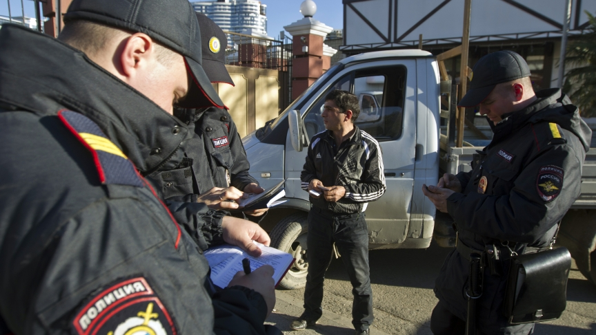 Russian police check a driver's documents in Sochi December 30, 2013. The International Olympic Committee has no doubt Russian authorities will be able to provide security at the Winter Olympics, a spokeswoman said on Monday after two bomb blasts killed t