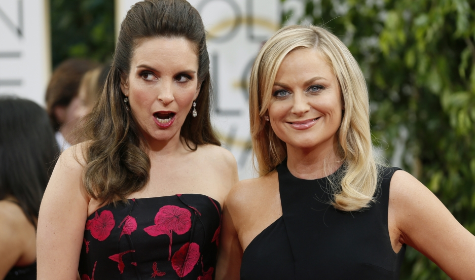Golden Globes hosts Tina Fey and Amy Poehler pose at the 2014 Golden Globe Awards.