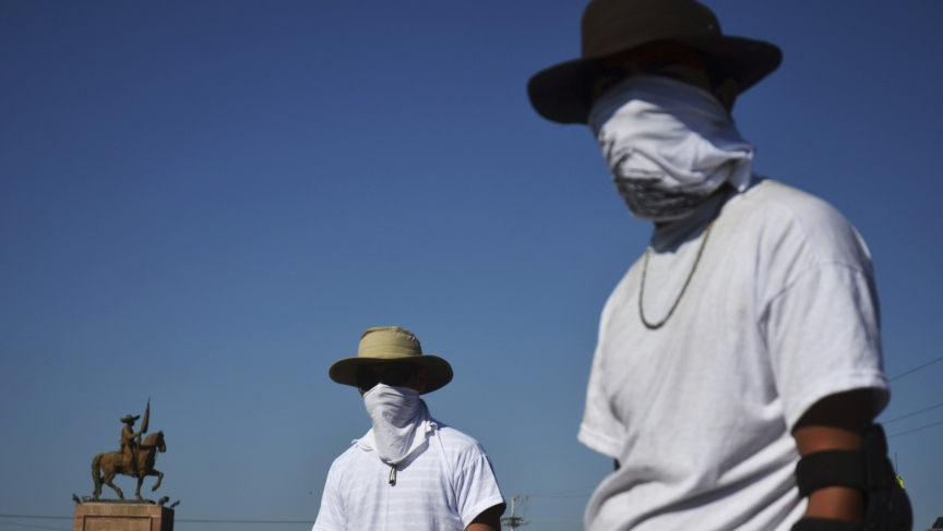 Vigilantes at a checkpoint near Apatzingan in Mexico's troubled state of Michoacan.