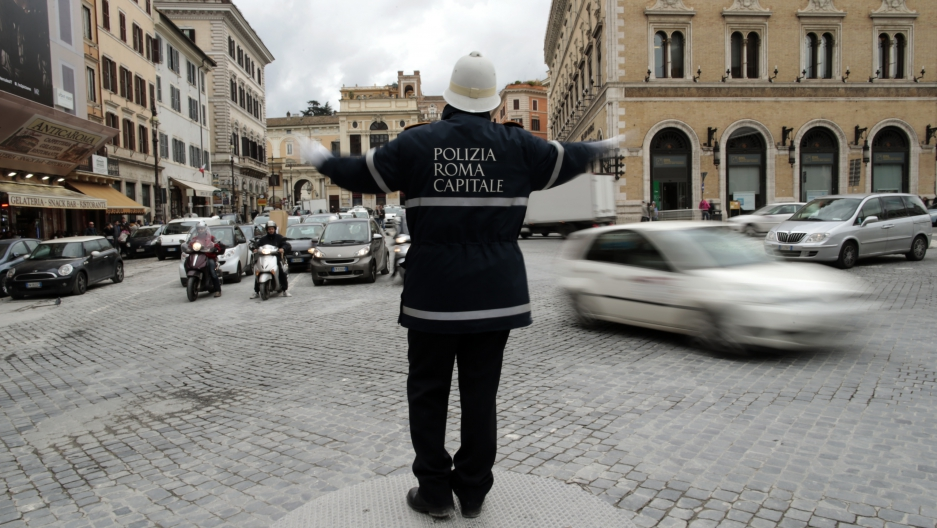 A police man directs traffic in Italy