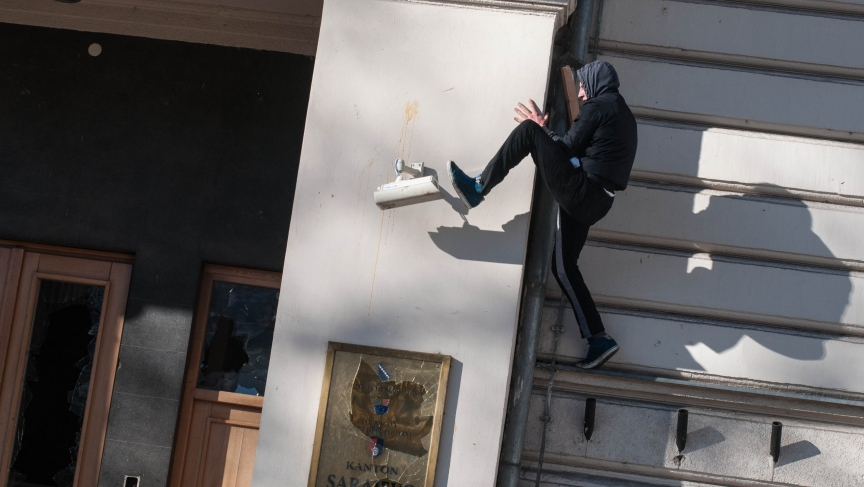 An anti-government protester kicks a surveillance camera during clashes with police in Sarajevo, Bosnia, on February 7, 2014.