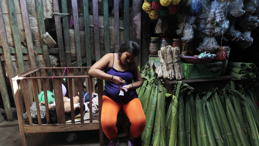 A woman sells banana leaves at a market in Managua, Nicaragua.