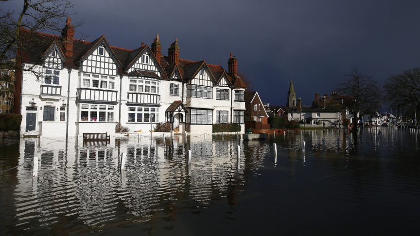 The river Thames floods the village of Datchet, southern England February 10, 2014. The British Government's top climate science agency says this winter's unrelenting rain is likely due at least in part to climate change.
