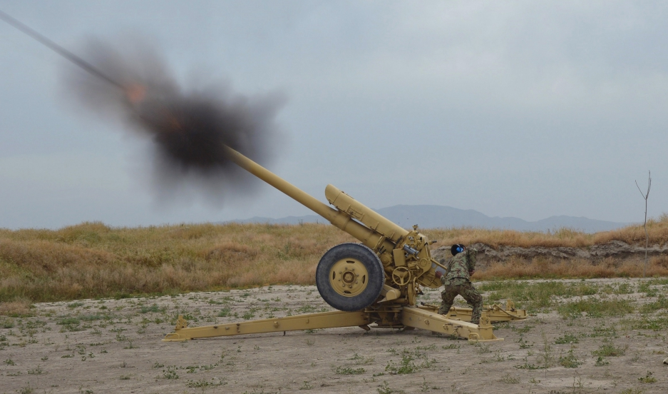 Afghan National Army soldiers fire artillery during a battle with Taliban insurgents in Kunduz on April 29, 2015.