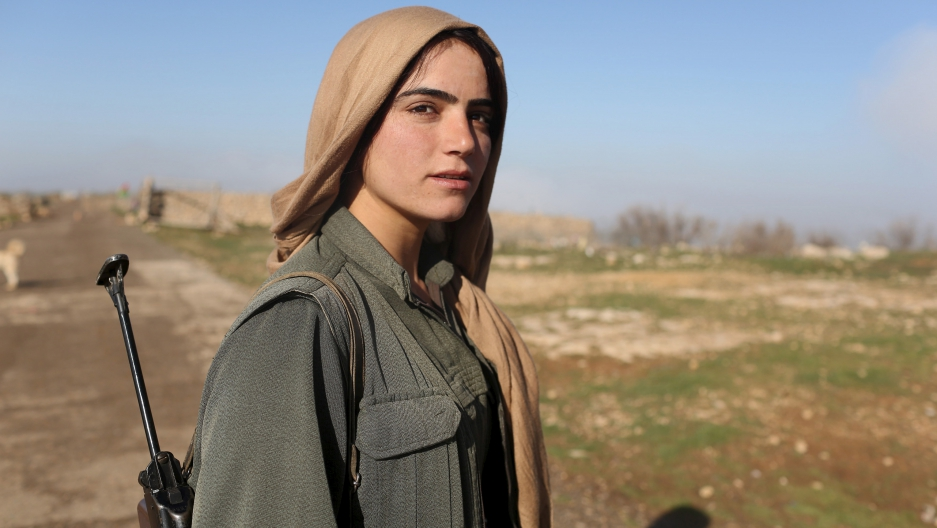 Boots on the ground, Iraq 2015. A female fighter of the Kurdistan Workers Party (PKK) - one of the groups involved in the new attack - stands near a security position near Sinjar, earlier this year.