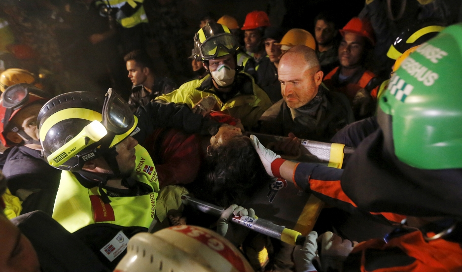 Earthquake survivor Krishna Kumari Khadka is rescued from a collapsed building in Kathmandu by French, Israeli and Norwegian rescue teams six days after the April 25, 2015 earthquake in Nepal.