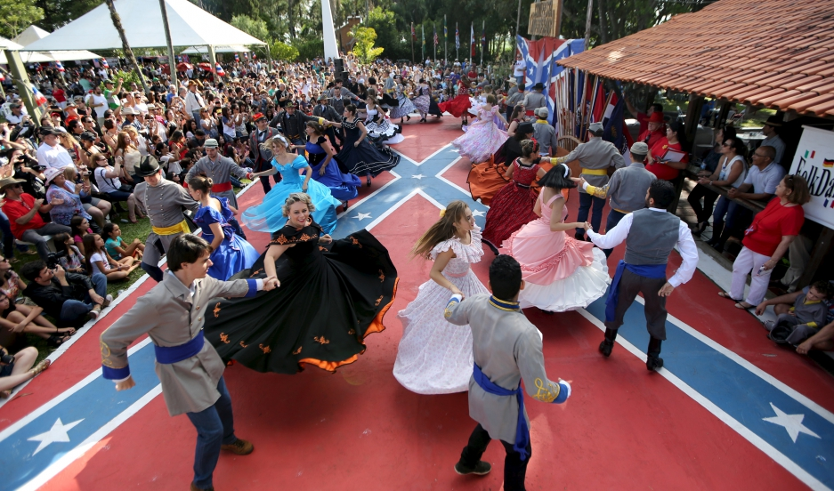 Descendants of American Southerners wearing Confederate-era dresses and uniforms dance during a party to celebrate the 150th anniversary of the end of the American Civil War in Santa Barbara D'Oeste, Brazil, April 26, 2015.