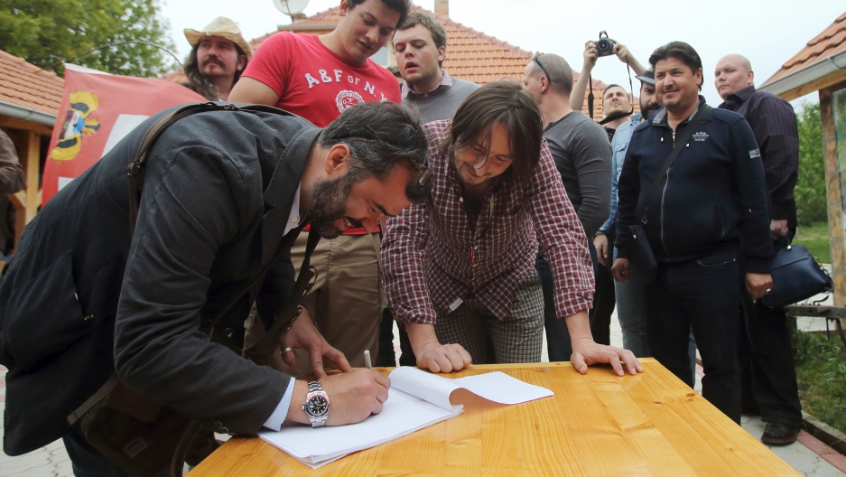 A man applies for Liberland citizenship in the village of Backi Monostor, Serbia May 1, 2015. A Czech citizen, Vit Jedlicka, has proclaimed a new sovereign state lying on the border between Croatia and Serbia.