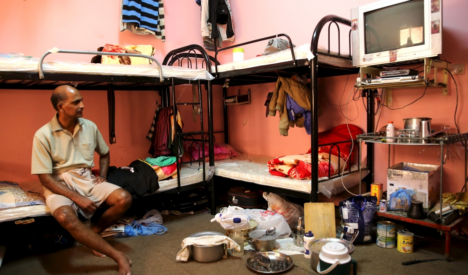 A laborer rests in a dormitory for foreign workers in the Sanaya Industrial Area in Doha during a government-guided tour, on May 3, 2015.