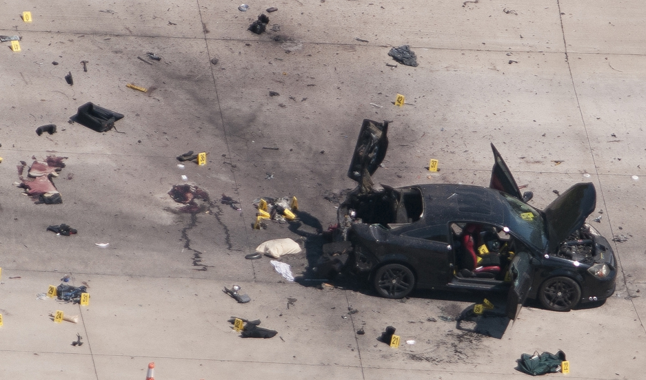 An aerial view shows the car that was used the previous night by two gunmen, who were killed by police, as it is investigated by local police and the FBI in Garland, Texas May 4, 2015.