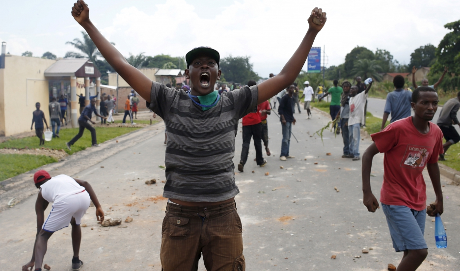 A man gestures during a protest in Bujumbura, Burundi, on May 13, 2015 against Burundian President Pierre Nkurunziza's decision to run for a third term.