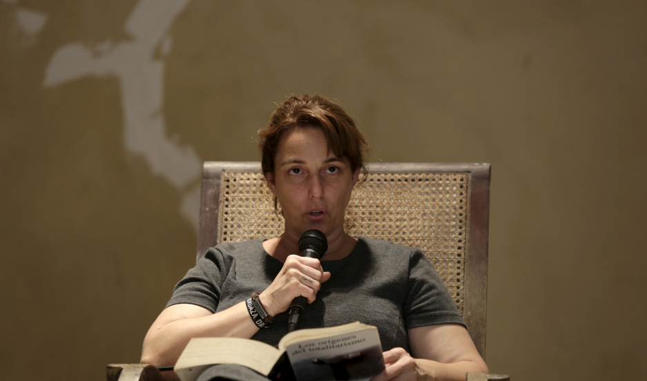"Cuban artist Tania Bruguera reads from Hannah Arendt's book ""The Origins of Totalitarianism."""