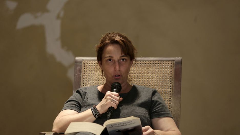 "Cuban artist Tania Bruguera reads from Hannah Arendt's book ""The Origins of Totalitarianism"" as part of a 100-hour collective reading in Havana May 20, 2015."