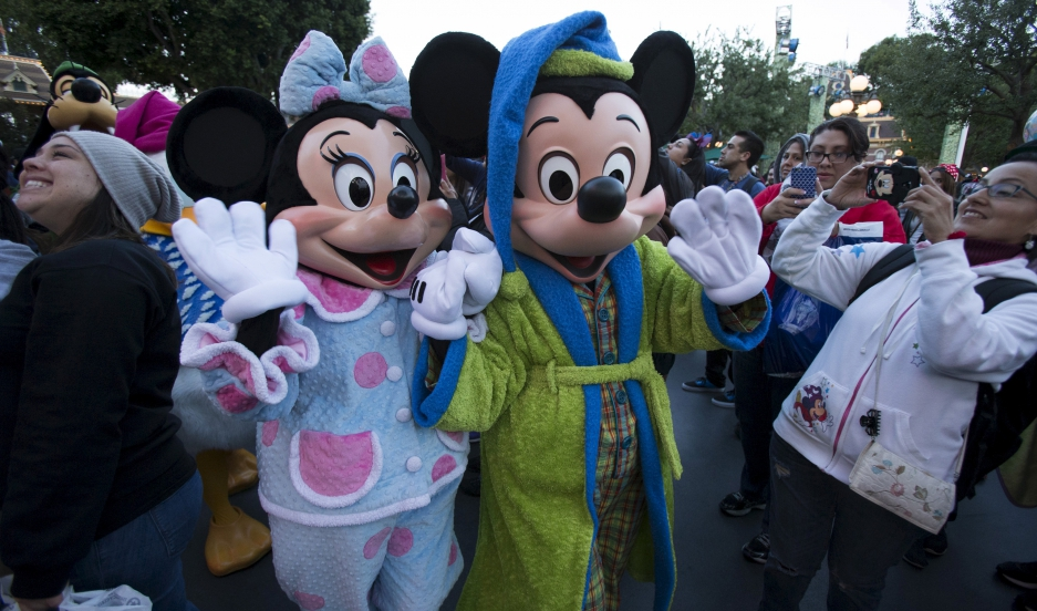The characters of Mickey Mouse and Minnie Mouse greet guests during Disneyland's Diamond Celebration in Anaheim, California May 23, 2015.