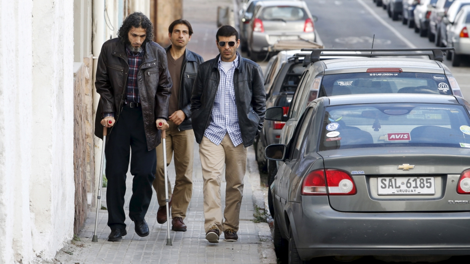 Former Guantanamo detainees from Syria (L-R) Jihad Diyab, Ahmed Adnan Ahjam and Ali Hussain Shaabaan, arrive to attend the wedding of fellow ex-detainee Abdul Bin Mohammed Abis Ourgy (not pictured) of Tunisia, in Montevideo, June 5, 2015. They are part of