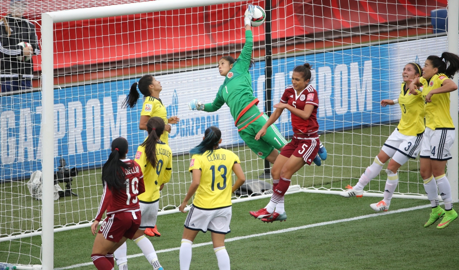 Mexico midfielder Veronica Perez scores a goal past Colombia goalkeeper Stefany Castano (1) during a Group F soccer match in the 2015 FIFA Women's World Cup at Moncton Stadium.