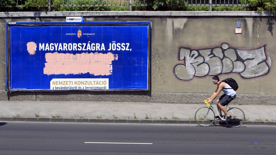 Government billboards vilifying immigrants destroyed by opposition activists are seen in Budapest, Hungary.