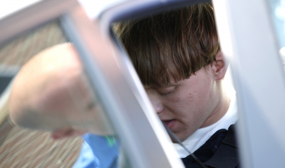 Suspected shooter Dylann Roof sits in a police vehicle in Shelby, North Carolina, June 18, 2015. Roof, a 21-year-old with a criminal record, is accused of killing nine people at a Bible-study meeting in a historic African-American church in Charleston, So