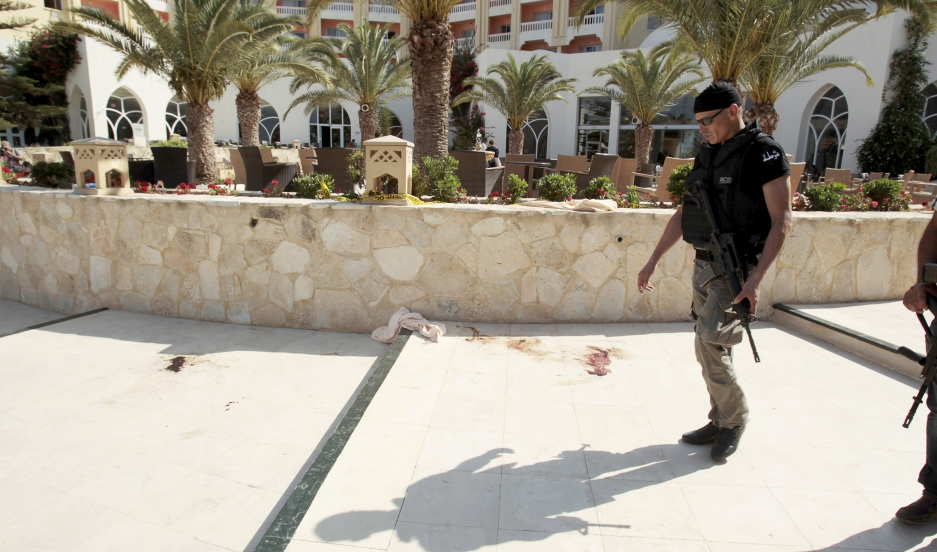 A police officer walks past blood at the Imperiale Marhaba hotel after a gunman opened fire at the beachside hotel in Sousse, Tunisia.