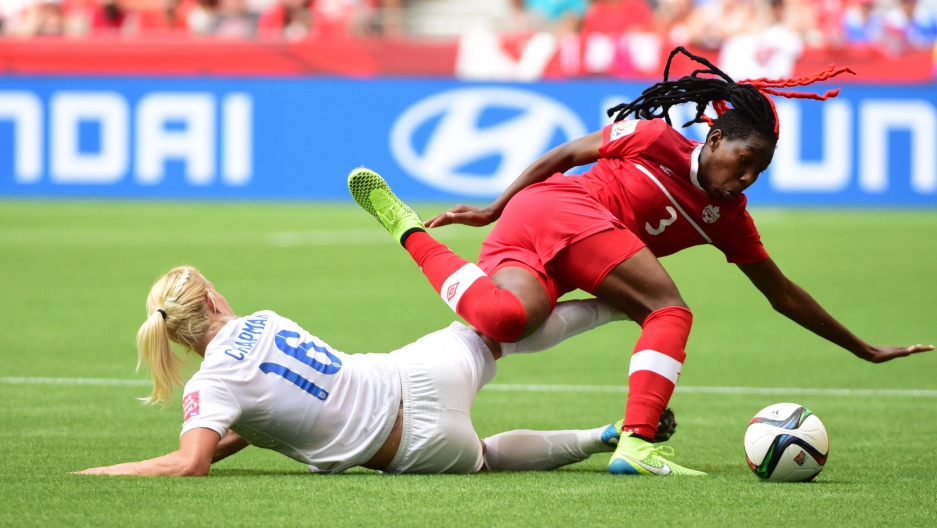 Jun 27, 2015; Vancouver, British Columbia, CAN; Canada defender Kadeisha Buchanan (3) falls against England midfielder Katie Chapman (16) during the second half in the quarterfinals of the FIFA 2015 Women's World Cup at BC Place Stadium.