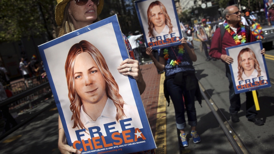 People hold signs calling for the release of imprisoned whistleblower Chelsea Manning in San Francisco, 2015