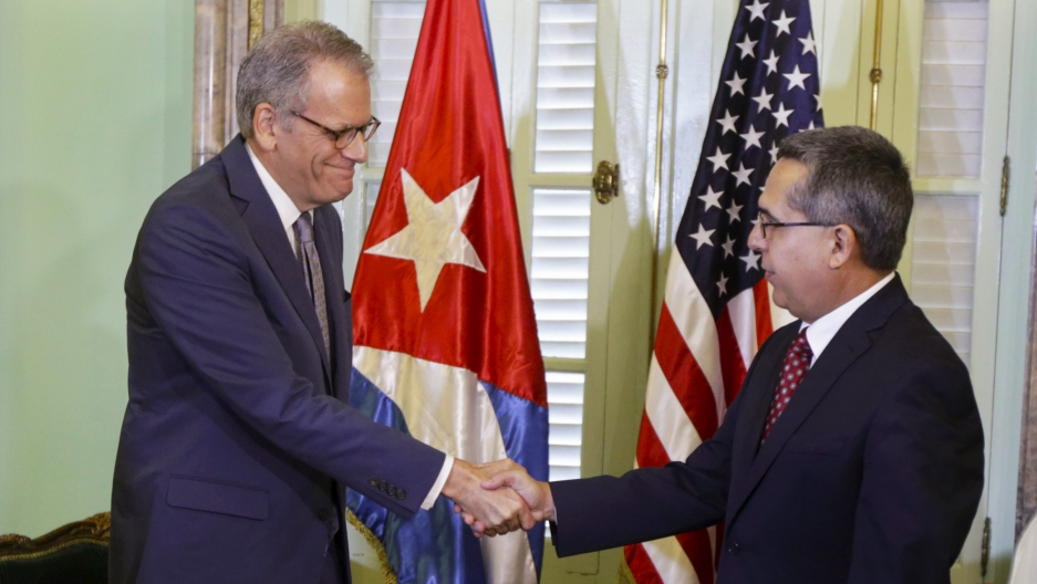 Chief of Mission at the US Interests Section in Havana Jeffrey DeLaurentis (L) shakes hands with Cuba's interim Foreign Minister Marcelino Medina in Havana July 1, 2015.