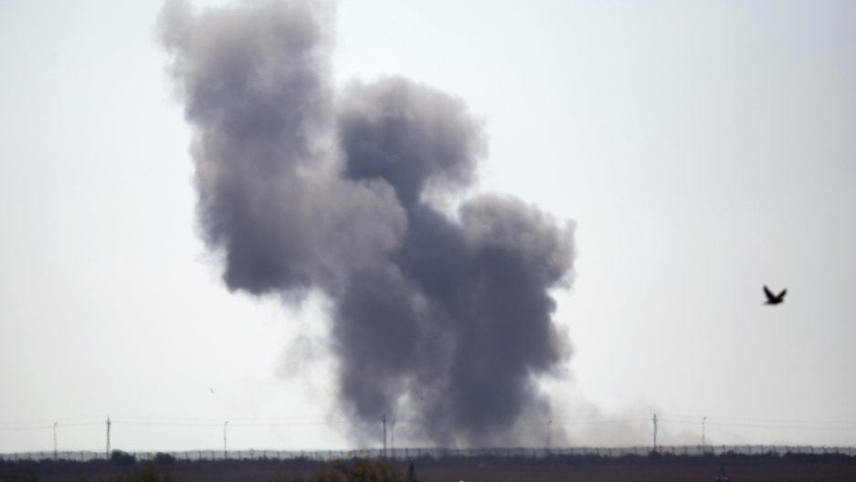 Smoke rises in Egypt as Islamic State militants launched a wide-scale coordinated assault on several military checkpoints in the northern Sinai, along the border with southern Israel