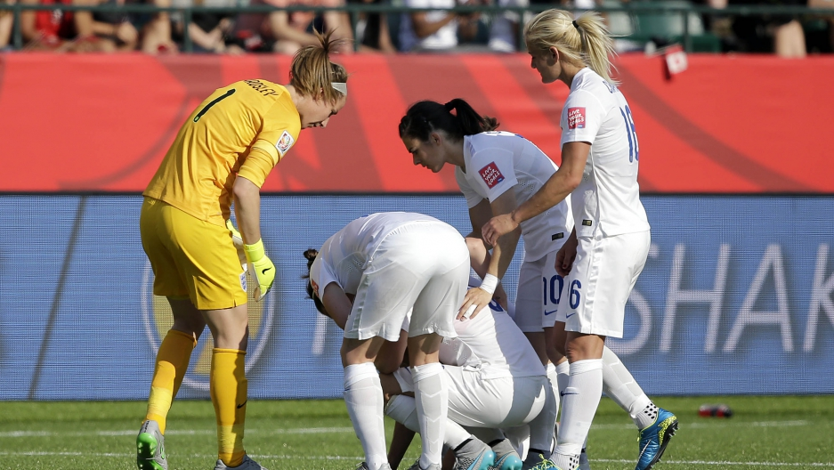 England reacts with England defender Laura Bassett (6) after she scored an own goal during the second half against Japan in the semifinals of the FIFA 2015 Women's World Cup at Commonwealth Stadium.