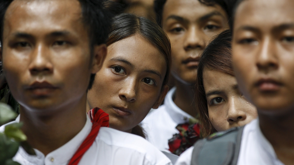 Demonstrators listen as a student leader gives a speech during a protest led by students at Yangon University in Myanmar July 7, 2015