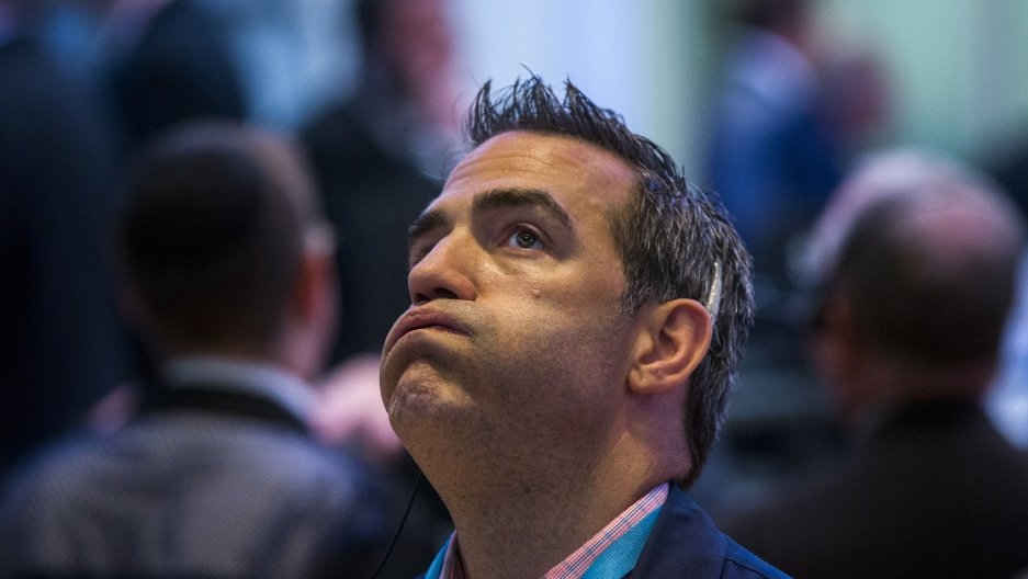 A trader waits for the NYSE to come back online