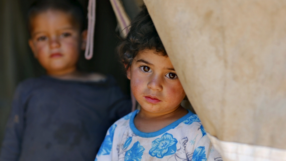 A Syrian refugee child who has been living in a tent in Jordan since fleeing her hometown of Idlib.