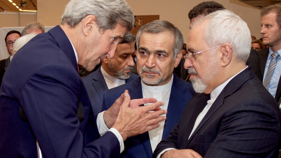 US Secretary of State John Kerry (L) speaks with Hossein Fereydoun (C), the brother of Iranian President Hassan Rouhani, and Iranian Foreign Minister Javad Zarif (R), before the Secretary and Foreign Minister addressed an international press corps gathere