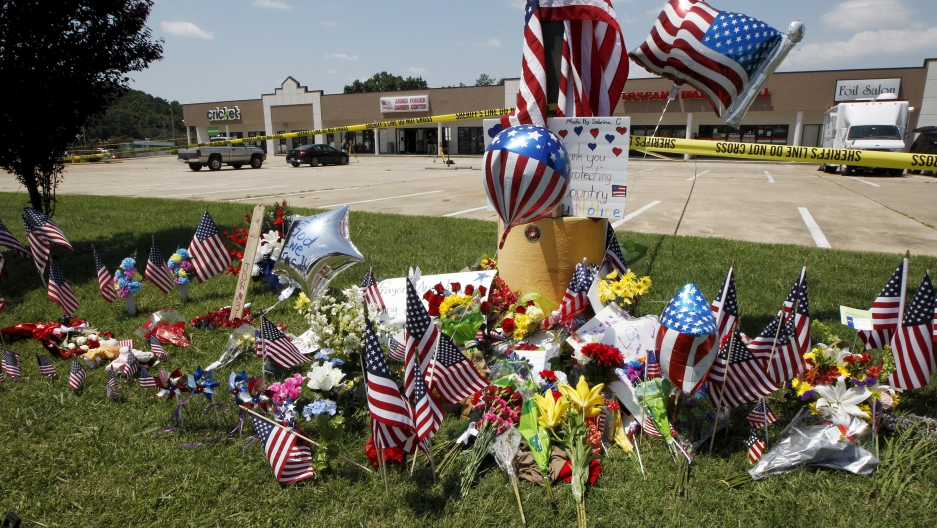 Items left at a memorial at the Armed Forces Career Center are seen in Chattanooga, Tennessee.