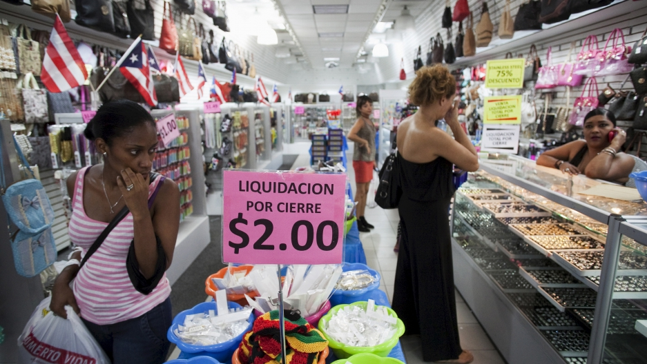 People shop in a store in San Juan, Puerto Rico, August 3, 2015.