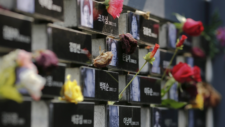 "Flowers are placed on a memorial wall commemorating the late former South and North Korean ""comfort women"" at the War and Women's Human Rights Museum"" in Seoul, South Korea, July 22, 2015. ""Comfort women� is the Japanese euphemism for women who were f"