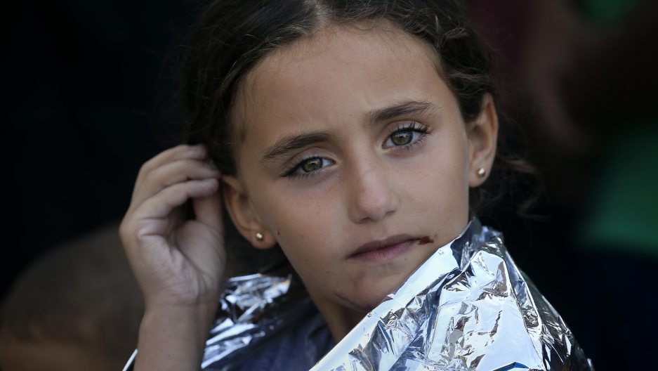 A young Syrian girl is wrapped with a thermal blanket following a rescue operation on the island of Lesbos, in Greece.