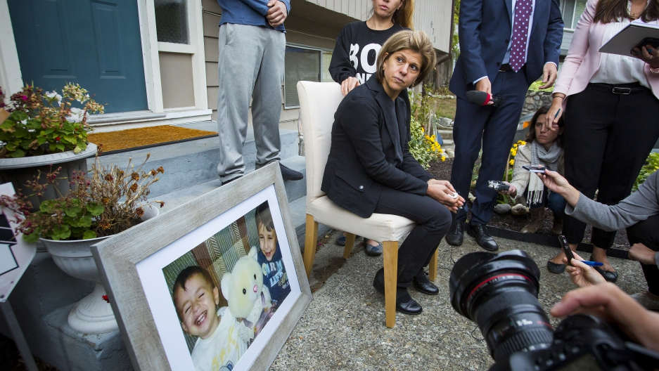 Tima Kurdi, sister of Syrian refugee Abdullah Kurdi, whose sons Alan and Galip and wife Rehan were among 12 people who drowned in Turkey trying to reach Greece, cries while speaking to the media outside her home in British Columbia.