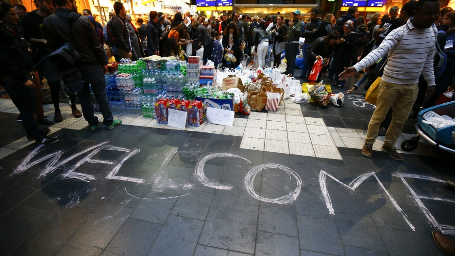 Water, food, and a welcome sign greeted refugees who reached Frankfurt, Germany