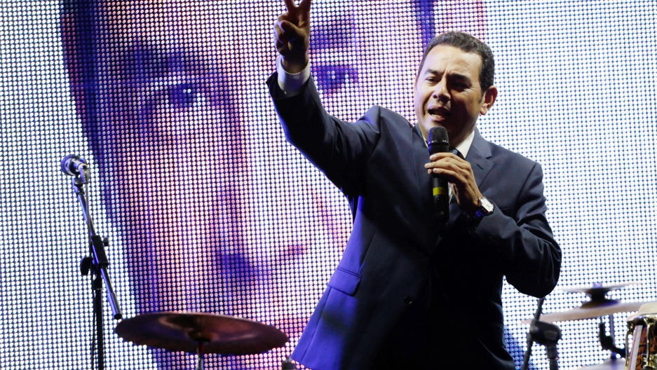 Guatemalan presidential candidate for National Convergence Front, Jimmy Morales, flashes the victory sign as he addresses supporters outside his campaign headquarters in Guatemala City, September 6, 2015.